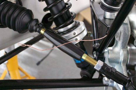 Using some copper wire to thread indicator cable through cycle wing